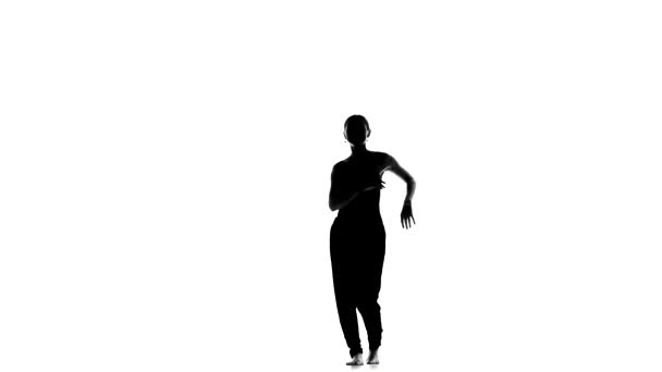 Young social latina dancer continue dancing, barefoot, on white, silhouette
