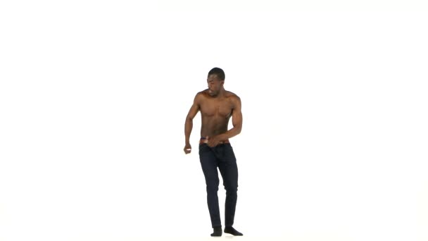 Afro american man dancer with naked torso dancing latina dance on white