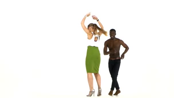 Social latino dancers, european girl and afro american man dancing on white