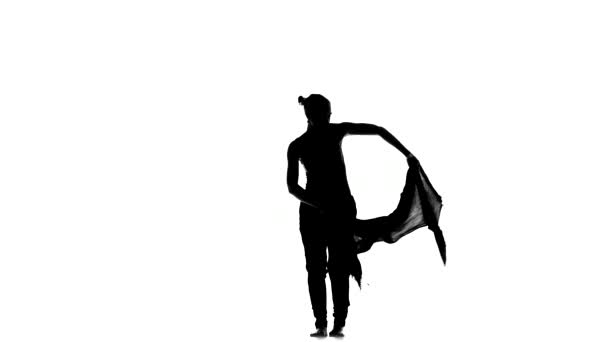 Slim professional dancer performs social latino dance, on white, silhouette