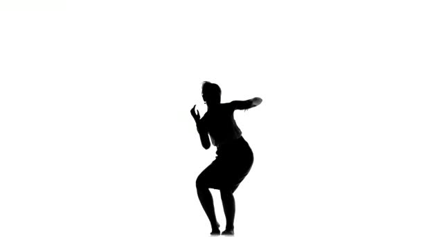 Slim professional dancer woman starts dancing social latino dance, on white, silhouette