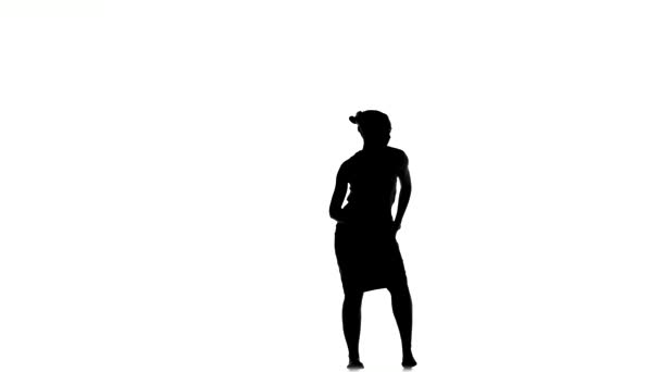 Slim professional dancer woman continue dancing social latino dance, on white, silhouette