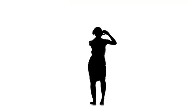 Slim professional dancer woman finish dancing social latino dance, on white, silhouette