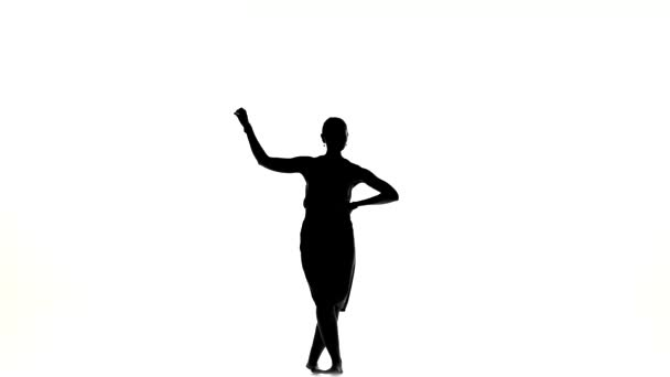 Beautiful dancer woman go on dancing social latino dance barefoot, on white, silhouette