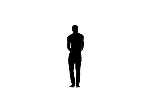 Afro american man dancer with naked torso starting dancing social latina dance on white, silhouette