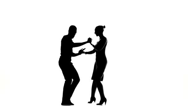 Young girl and afro american man with naked torso go on dancing social latino dancers dancing on white, silhouette