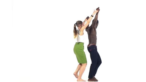 Social latino dancers, european girl and afro american man starts dancing on white, slow motion
