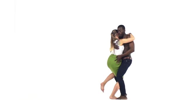 Attractive social latino dancers, european girl and afro american man go on dancing on white, slow motion
