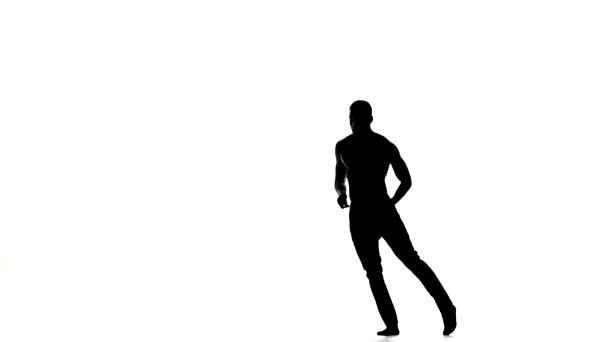 Afro american man dancer with naked torso dancing latina dance on white, silhouette, slow motion
