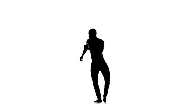 Afro american man with naked torso go on dancing social latina dance on white, silhouette, slow motion