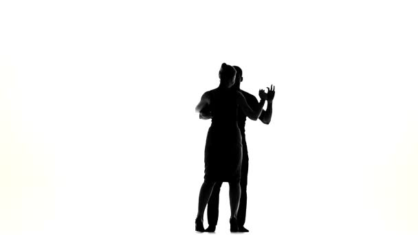 Latino dancers in action, silhouette, on white, slow motion