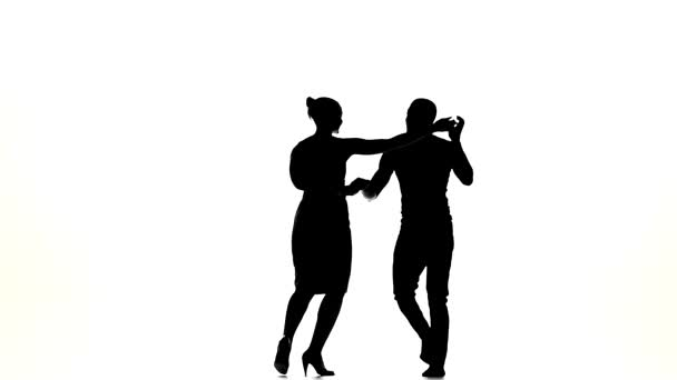 Social latino dancers, european girl and afro american man continue dancing on white, silhouette, slow motion