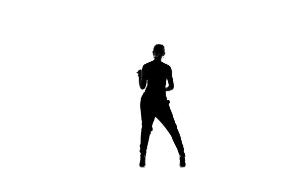 Professional dancer performs social latino dance, on white, slow motion, silhouette