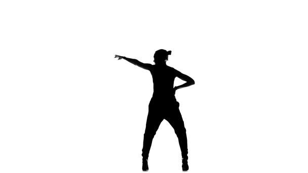 Beautiful dancer woman starts dancing social latino dance barefoot, on white, slow motion, silhouette