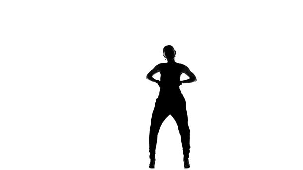 Young social latin dancer continue moves dancing, on white, slow motion, silhouette