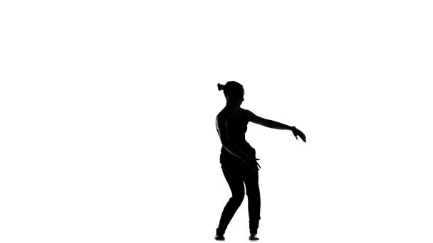 Young, cool social latin dancer girl starts moving dancing, on white, slow motion, silhouette