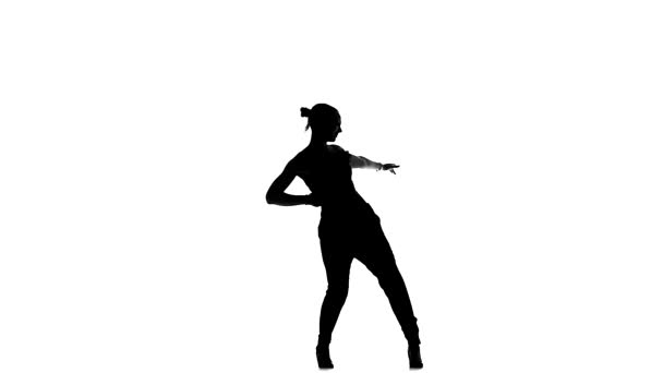 Attractive social latin dancer girl making moves dancing, on white, slow motion, silhouette