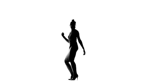 Talanted social latin dancer girl making moves dancing, on white, slow motion, silhouette
