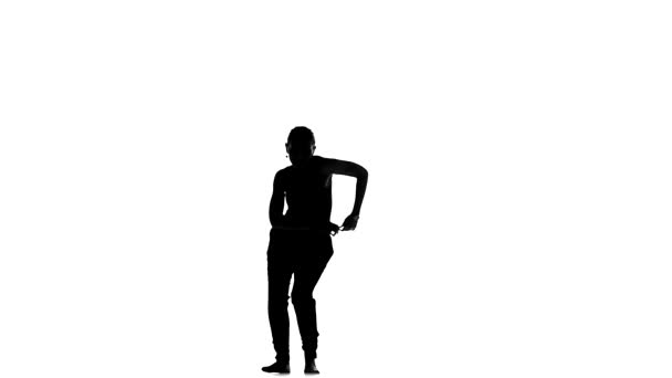 Professional, beautiful social latin dancer girl making moves dancing, on white, slow motion, silhouette