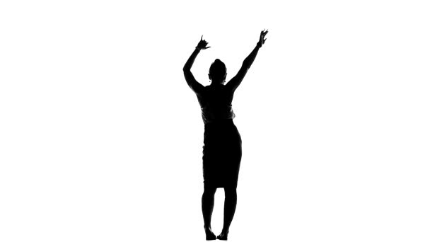 Attractive, european lady dancing social latin dance, slow motion, silhouette