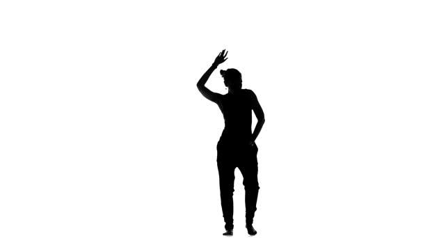 Beautiful, lady starts dancing social latin dance, slow motion, silhouette