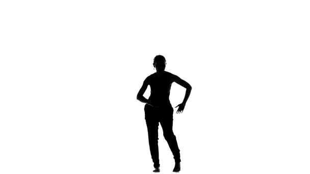 Attractive, talanted girl dancing social latino dancers on white, slow motion, silhouette