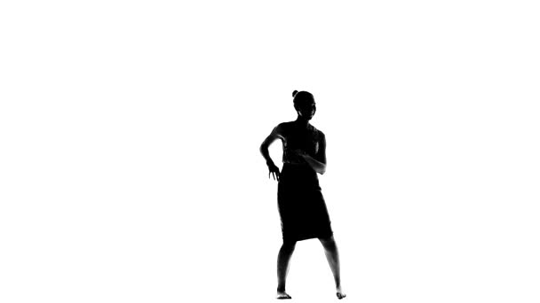 Young woman dancing social latino dancers on white, slow motion, silhouette