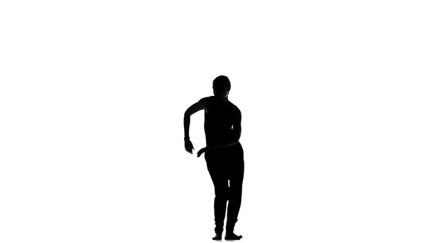 Afro american man dancer with naked torso starting dancing latina dance on white, slow motion, silhouette