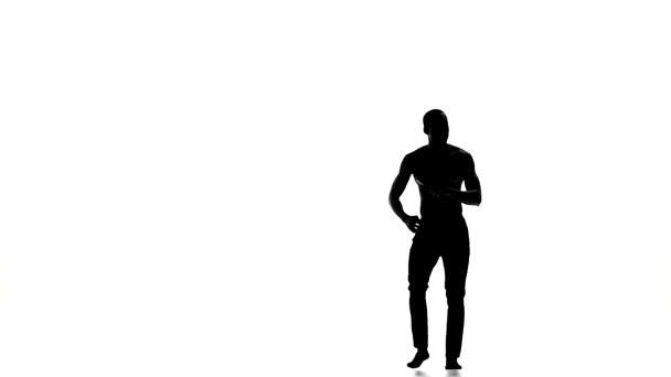 Afro american man dancer enjoy dancing social latina dance on white, slow motion, silhouette