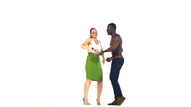 Couple of social latino dancers go on dancing on white, slow motion