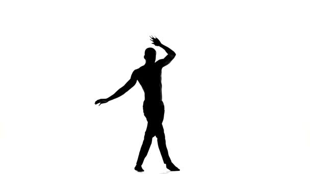 Attractive man dancer enjoy dancing great social latina dance on white, slow motion, silhouette