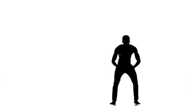 Attractive, slim man dancer enjoy dancing great social latina dance on white, slow motion, silhouette