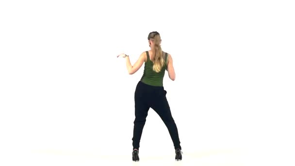 Young social latin dancer girl continue moving dancing, on white, slow motion