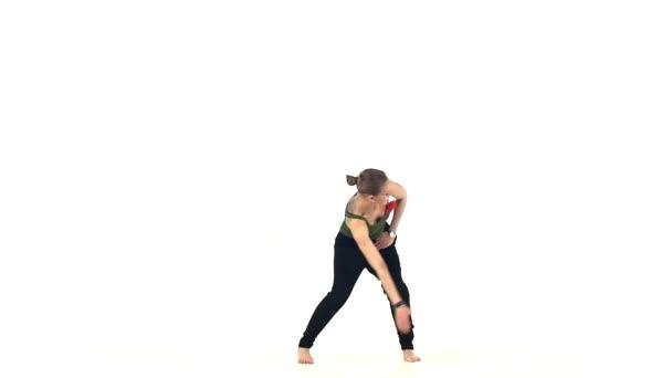 Beautiful young lady dancing social latin dance, slow motion