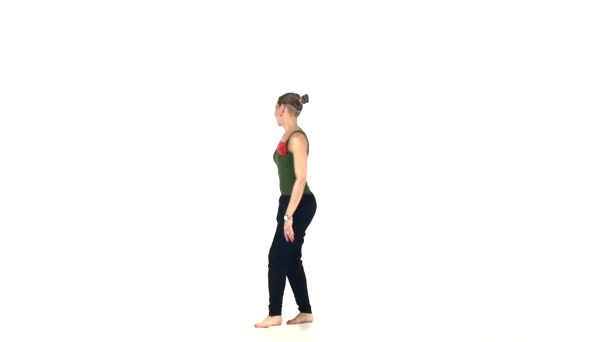 Attractive young lady dancing social latin dance, slow motion