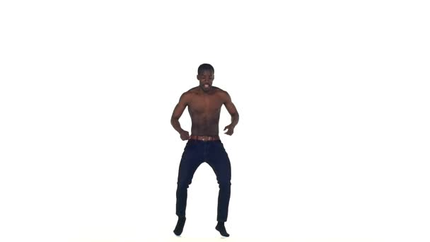 Afro american man dancer with naked torso starting dancing latina dance on white, slow motion