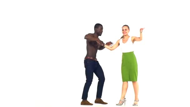 Couple of social latino dancers, european girl and afro american man starts dancing on white, slow motion