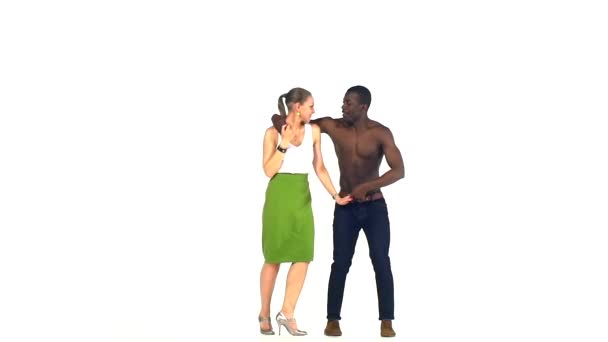 Couple of social latino dancers girl with ponytail and afro american man with naked torso go on dancing on white, slow motion