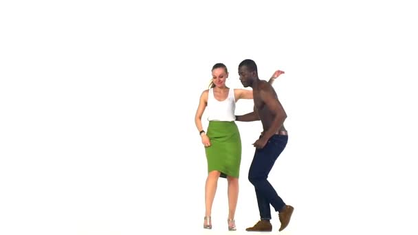 Couple of social latino dancers continue dancing on white, slow motion
