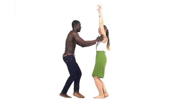 Talanted couple of social latin dancers starts dancing on white, slow motion
