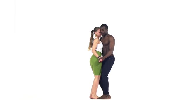 Professional couple of social latin dancers continue dancing on white, slow motion