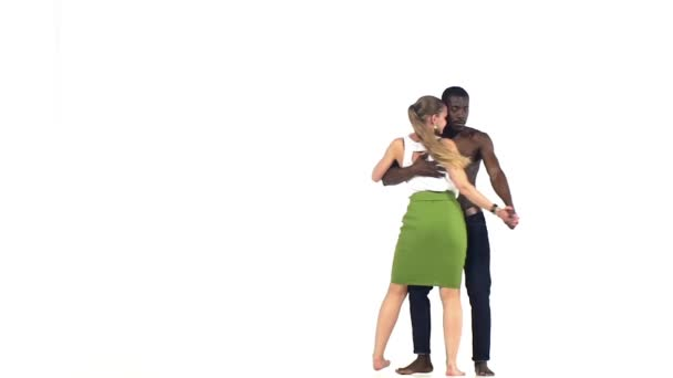 Professional couple of social latin dancers starts dancing on white, slow motion