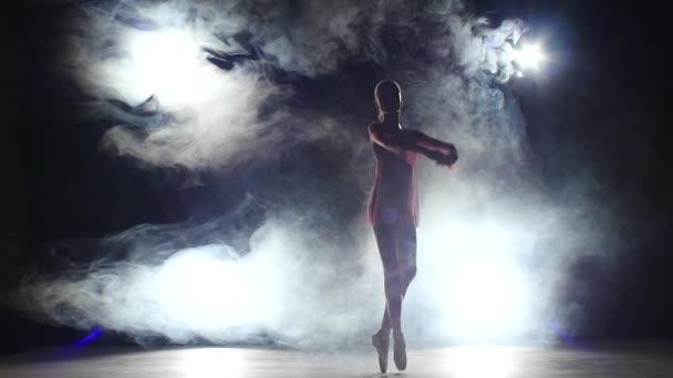 little ballet girl dancer in studio, smoke. silhouette. slow motion