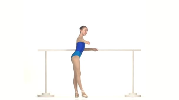 Young Ballerina in blue dress Posing on White Background