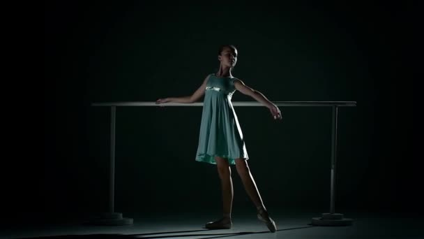 Young ballet dancer wearing an apricot tutu. slow motion