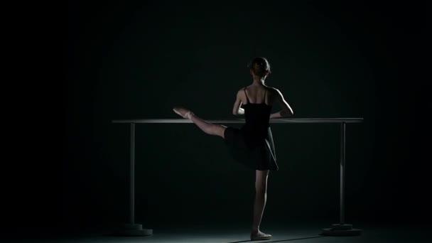 little ballet dancer wearing an apricot tutu. slow motion
