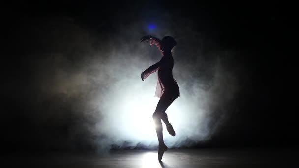 Beautiful bellet dancer dancing at studio.  silhouette. slow motion