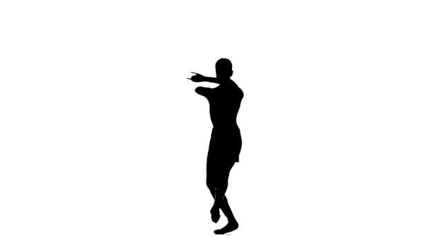 malá baletka, která pózala na bílém pozadí. Silueta. Zpomaleně