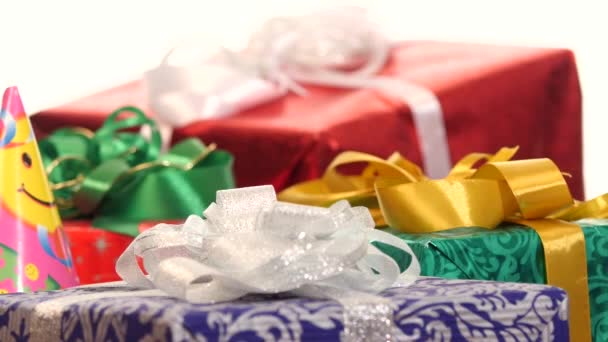 Lot of boxes, gifts tied with ribbons and bows isolated on white background, dynamic change of focus