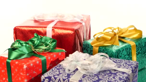 Different boxes, gifts tied with ribbons and bows isolated on white background, rotation